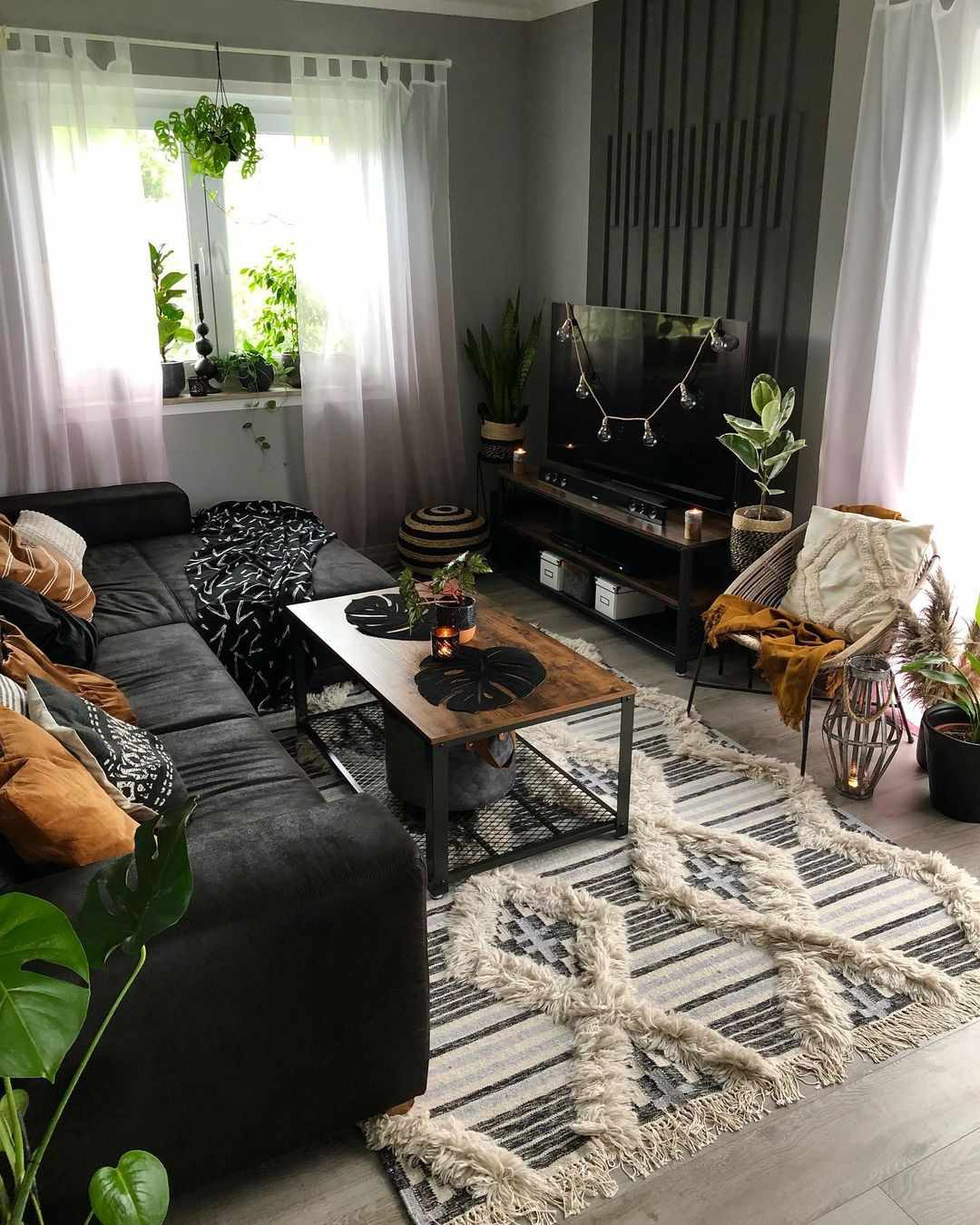 black living room with plants