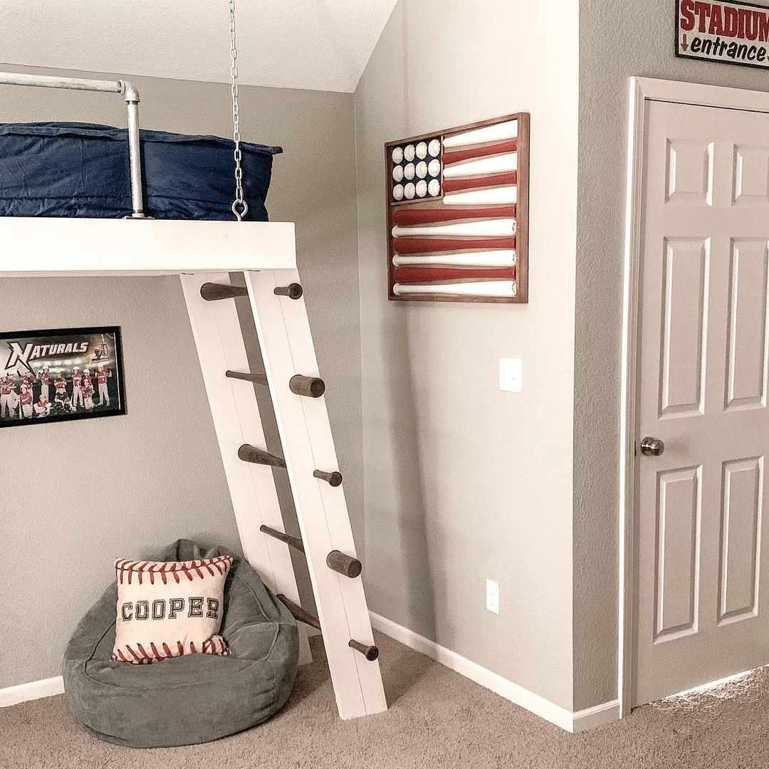 A kid's baseball-themed room featuring a loft-style bed, American flag decor and a bean bag chair.