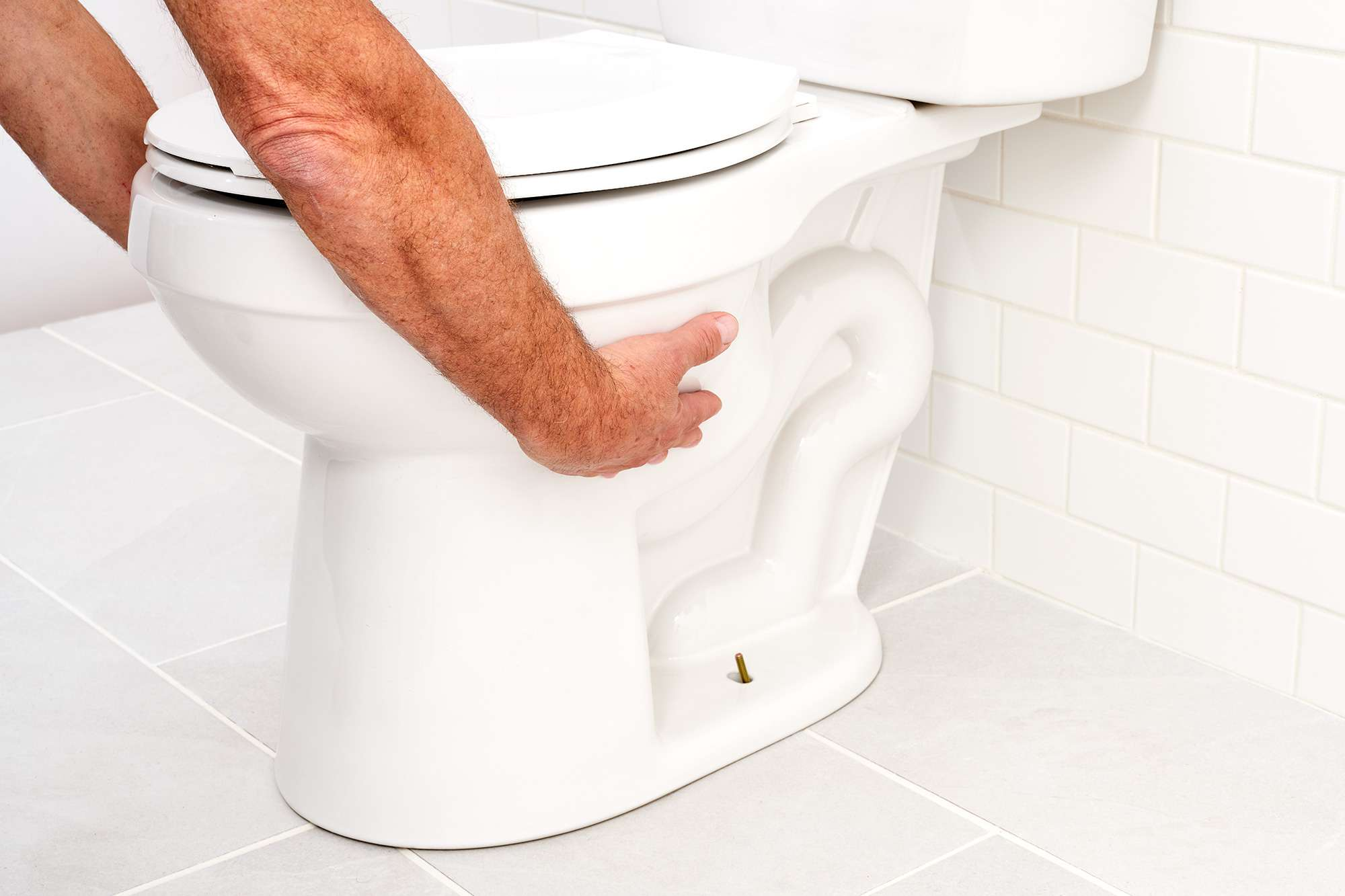 Toilet lifted by holding on to each side of bowl