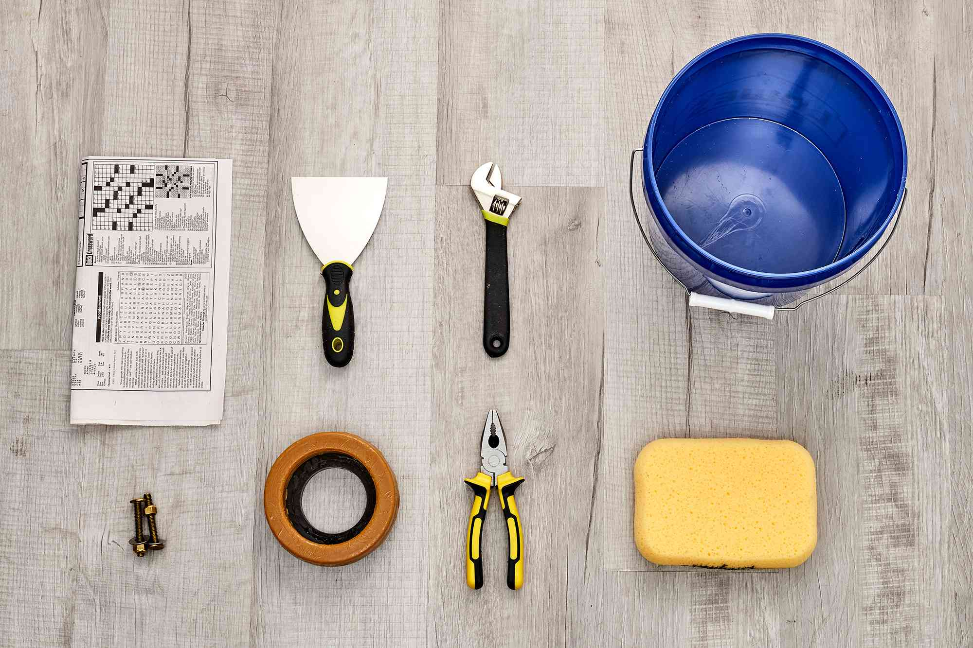 Materials and tools to reset a toilet