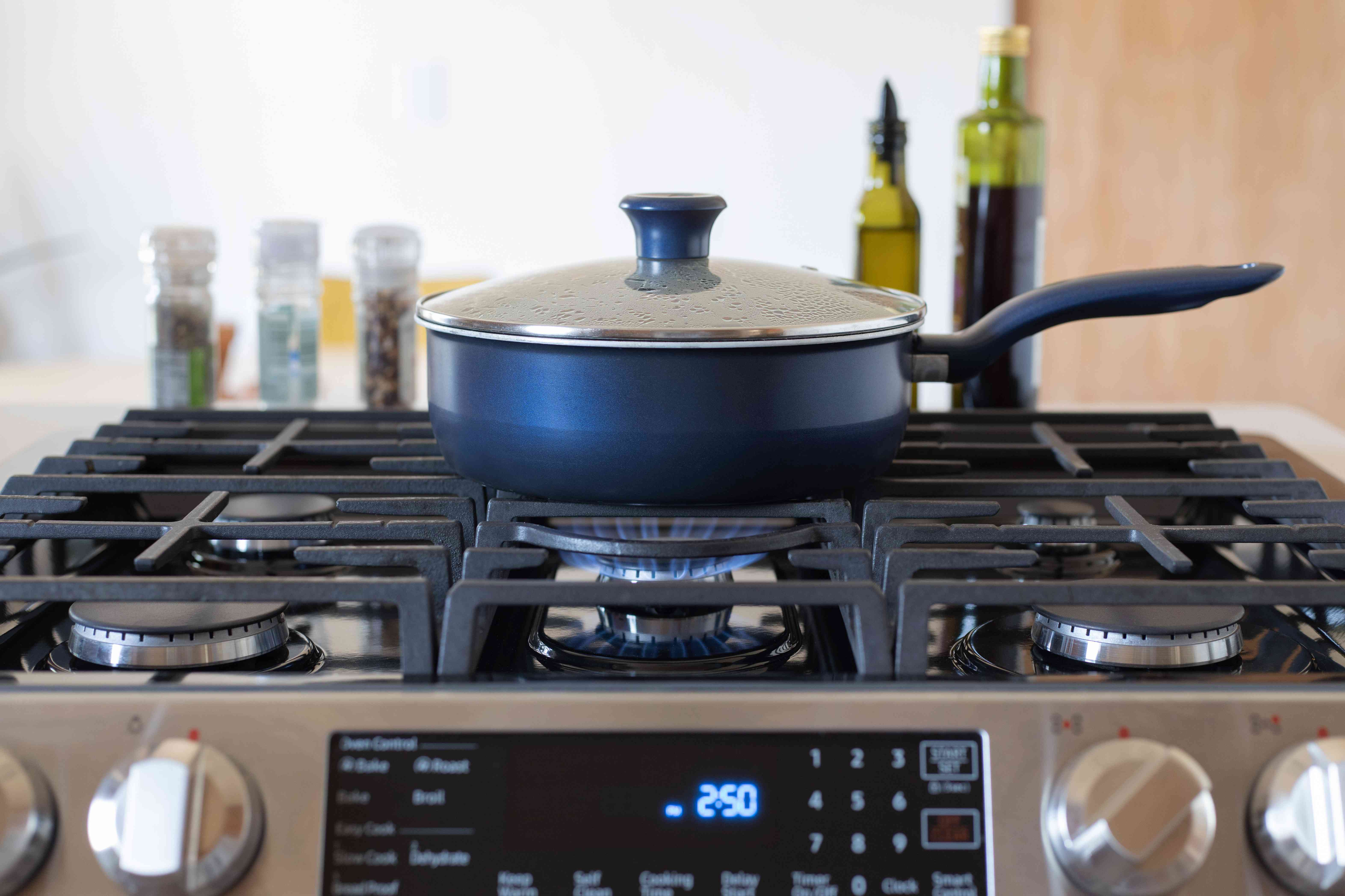Cook pan being used with lid on while gas stove is running