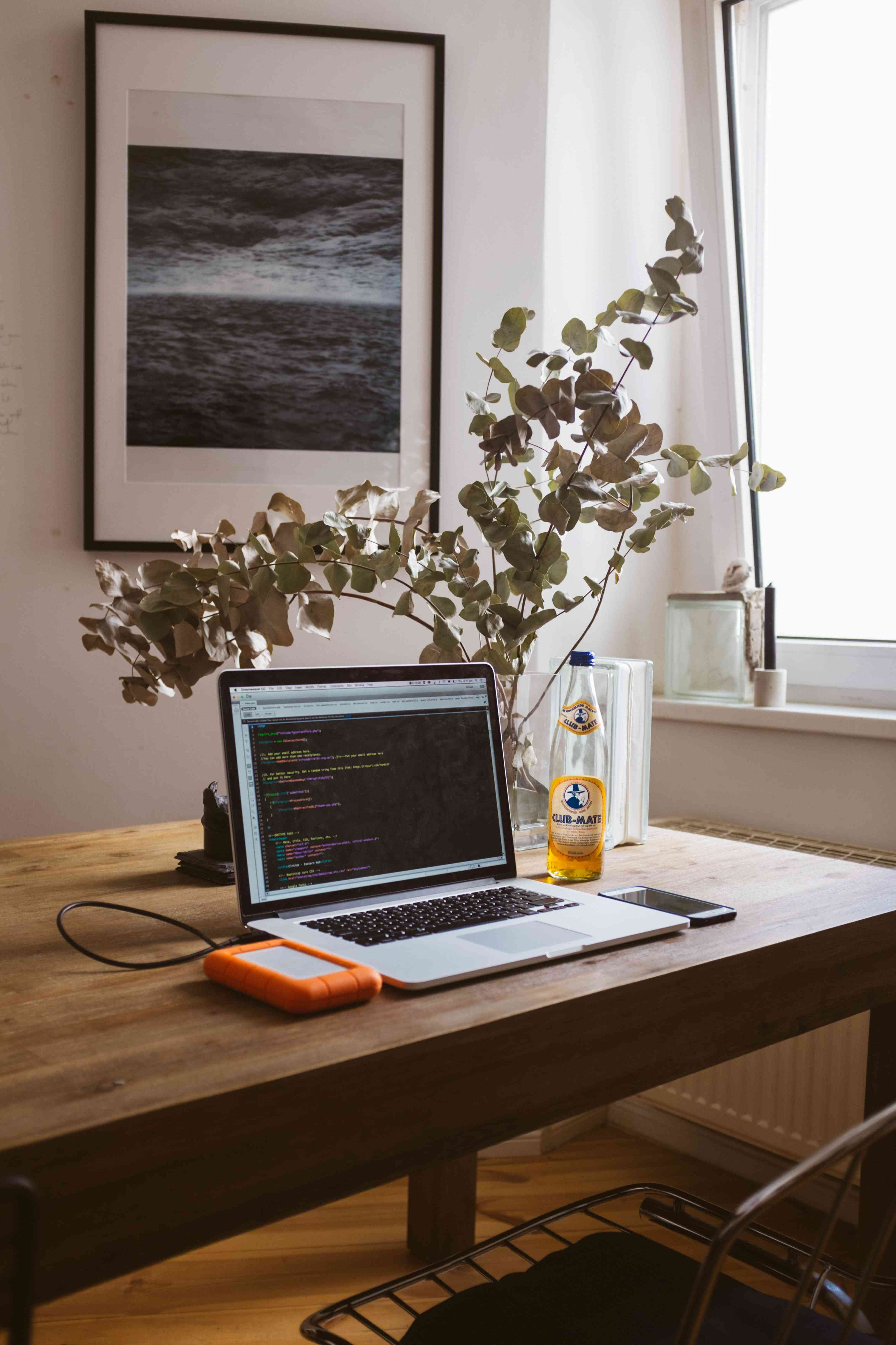 home office desk with laptop