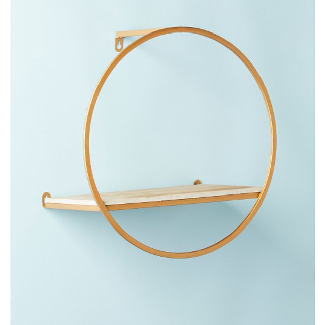 A round gold and wood shelf