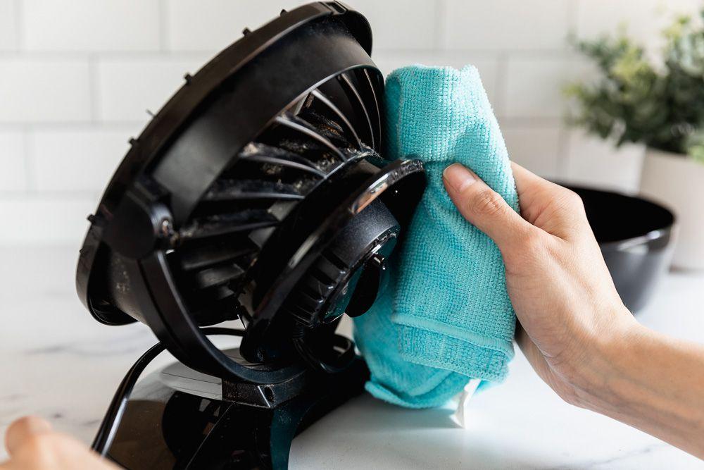 Black fan dried with blue microfiber cloth