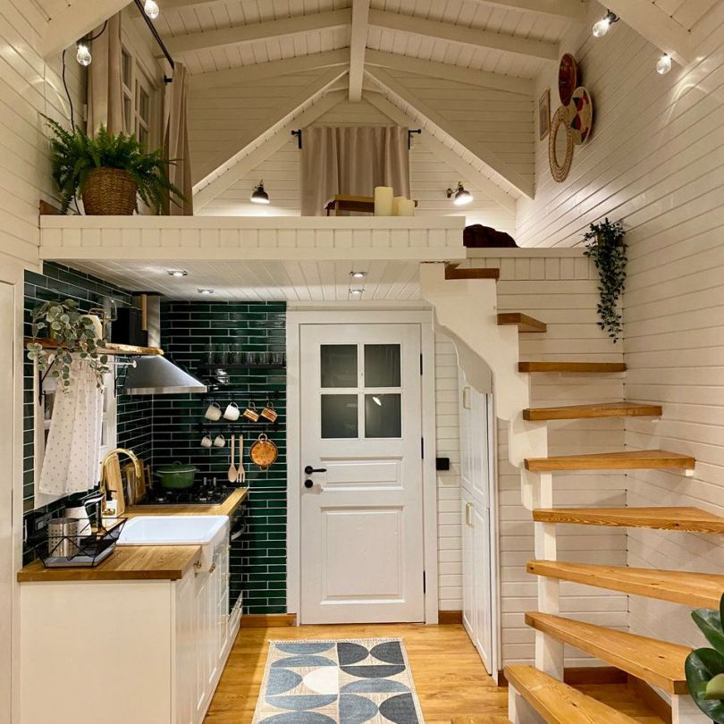 tiny home kitchen with green subway tile and white shiplap