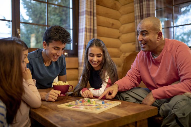 Family plays board game