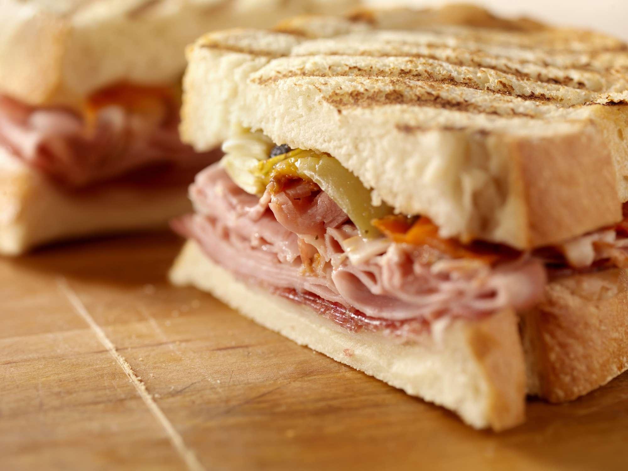 A close-up of a bologna sandwich.