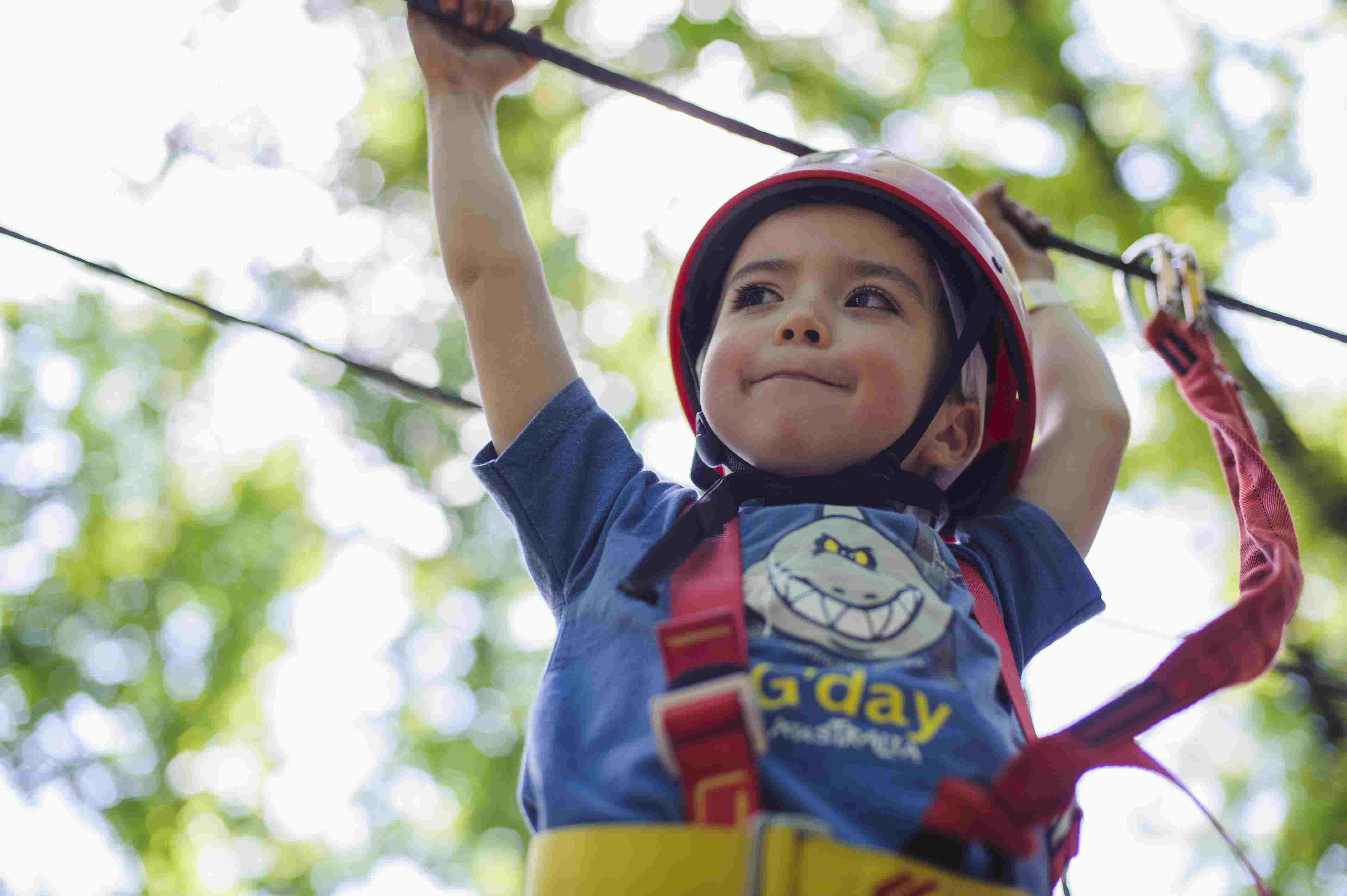 Young boy in an obstacle course