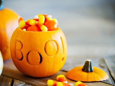 Carved Halloween pumpkin filled with candy corn