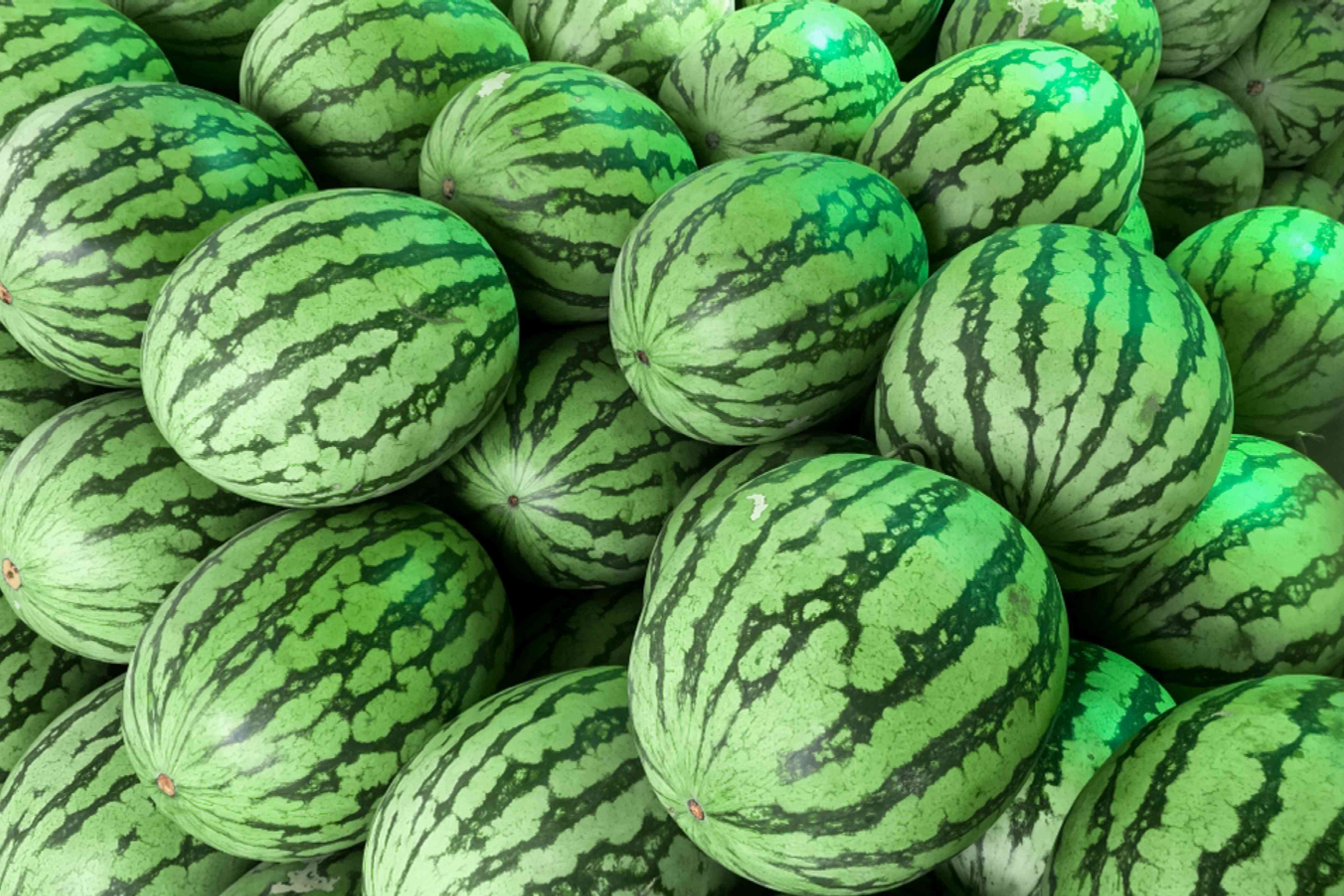 Yellow watermelons stacked on each other