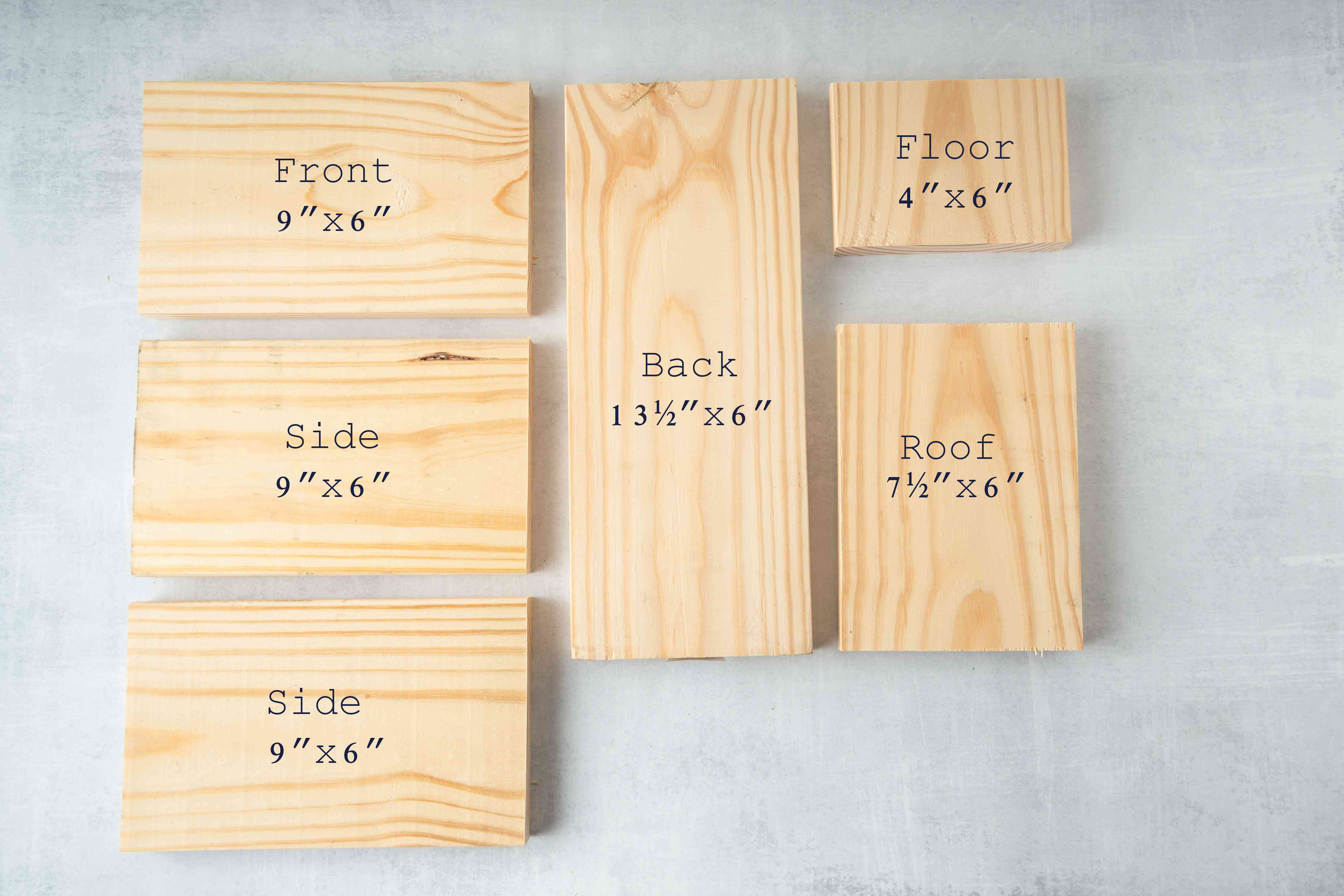 Several pine boards cut out for a birdhouse.