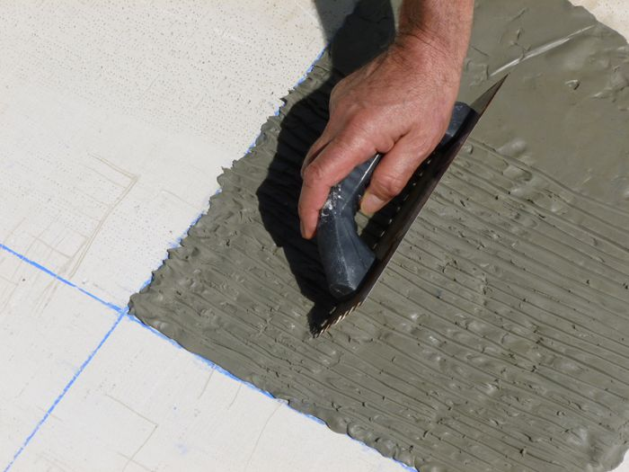 Applying thinset with a notched trowel