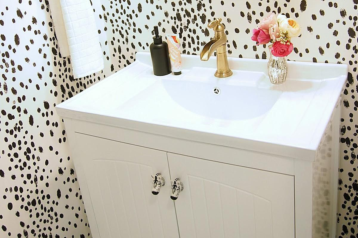 dotted wallpaper chic bathroom