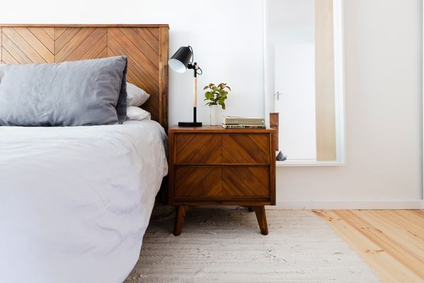 area rug placement in a small bedroom