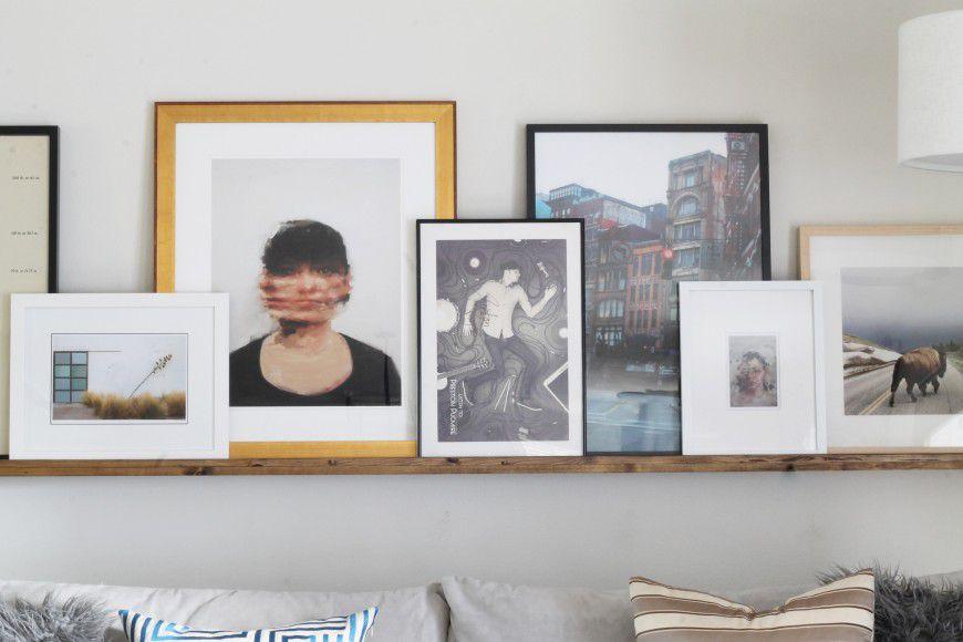 Artwork on floating ledge shelf