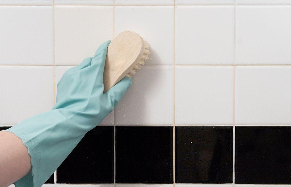 scrubbing a shower wall