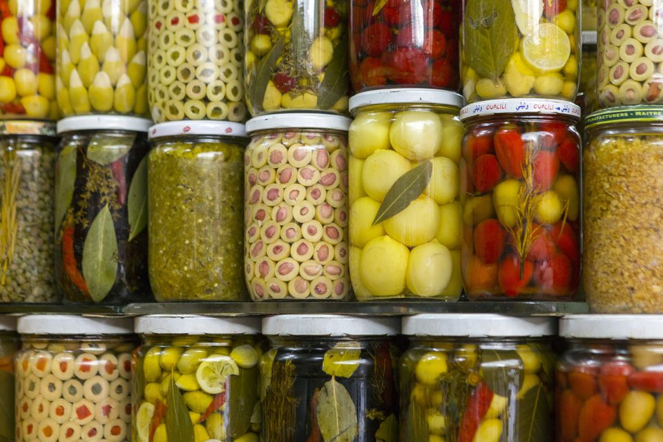Preserved lemons, olives and pickles in a pantry