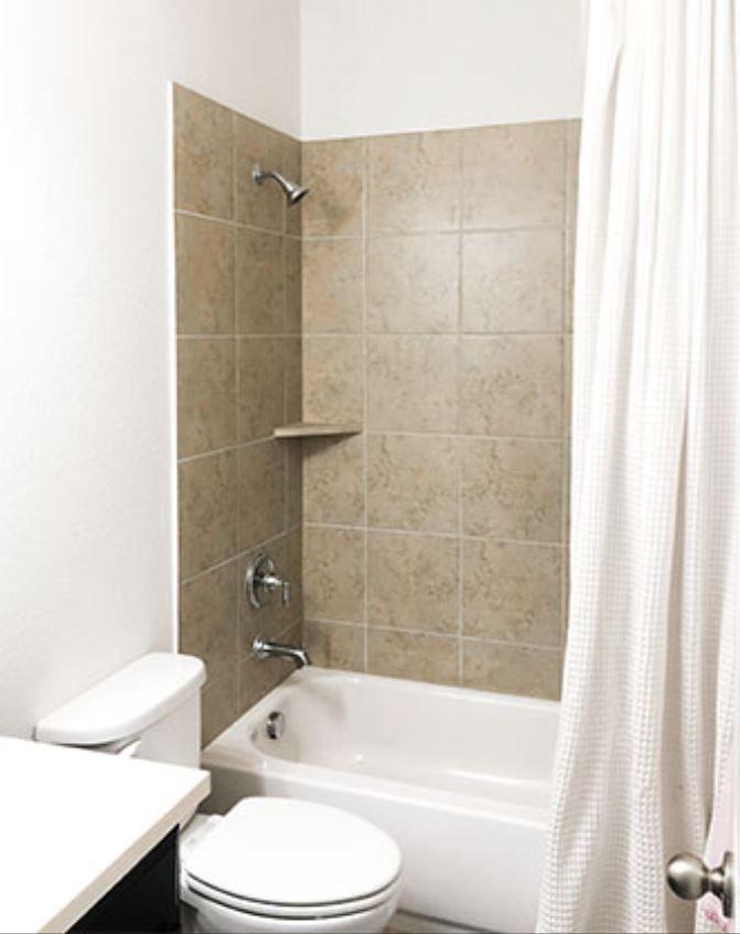 Boring builder-grade bathroom with brown tile in shower.