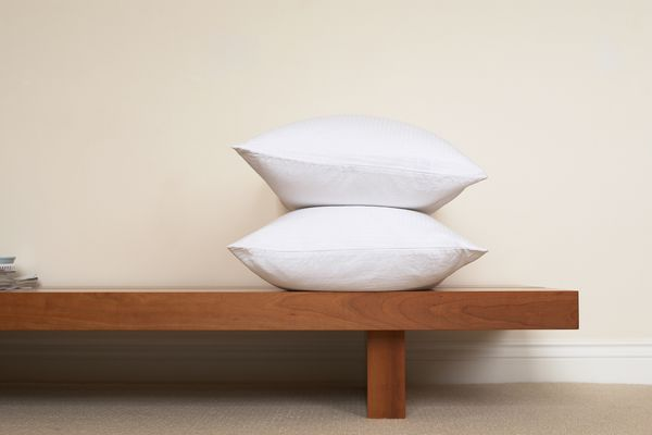 Two pillows on a low wooden bench