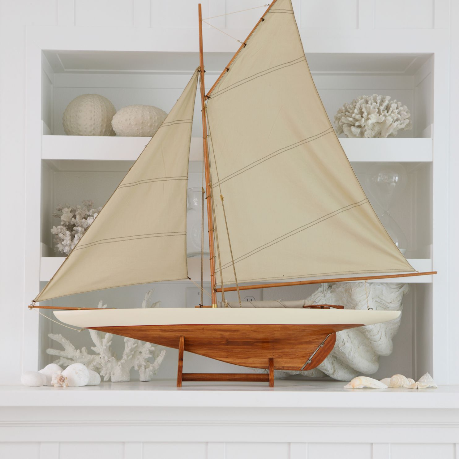 Beach house mantle with a model ship