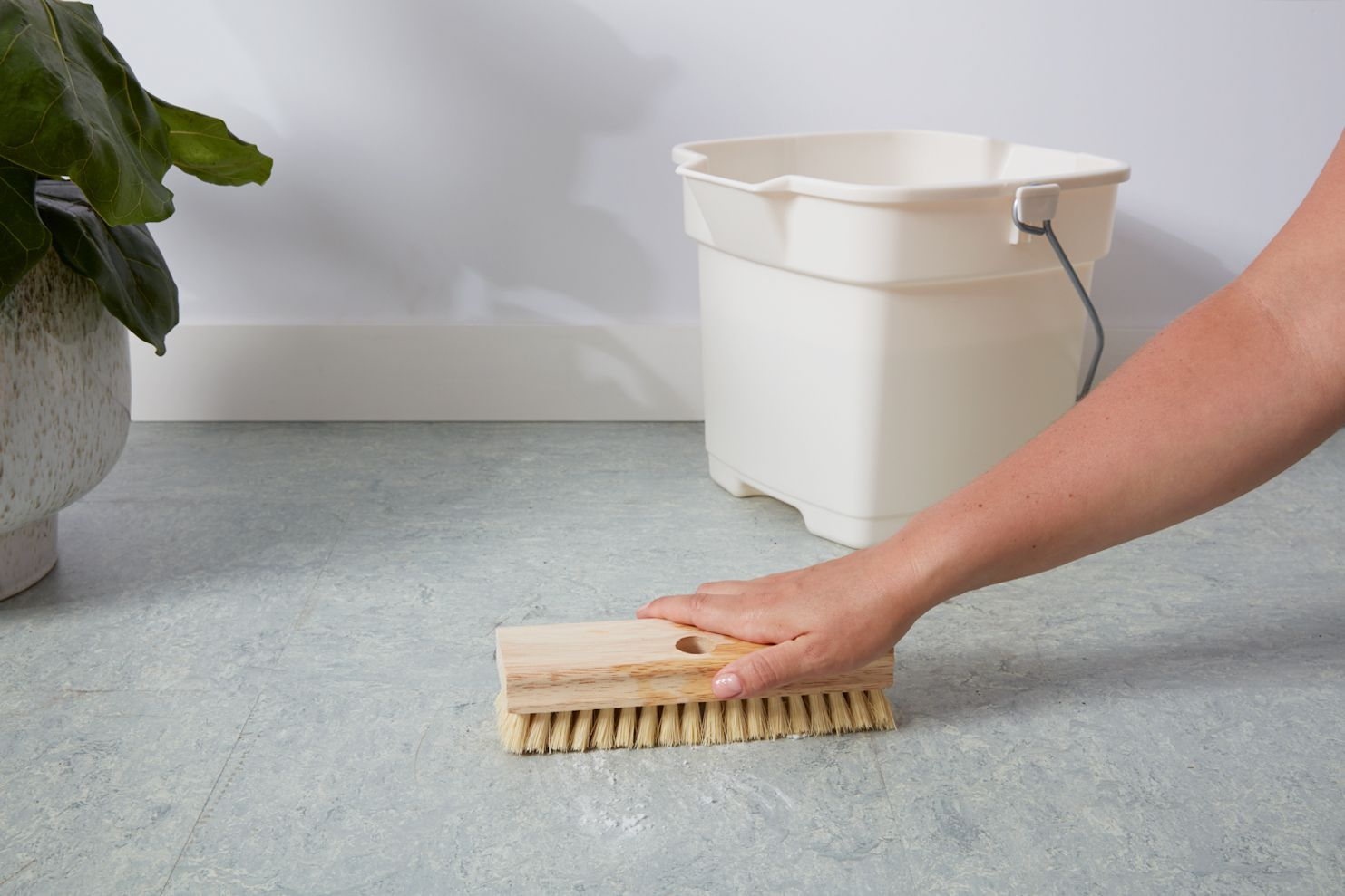 person cleaning a linoleum floor