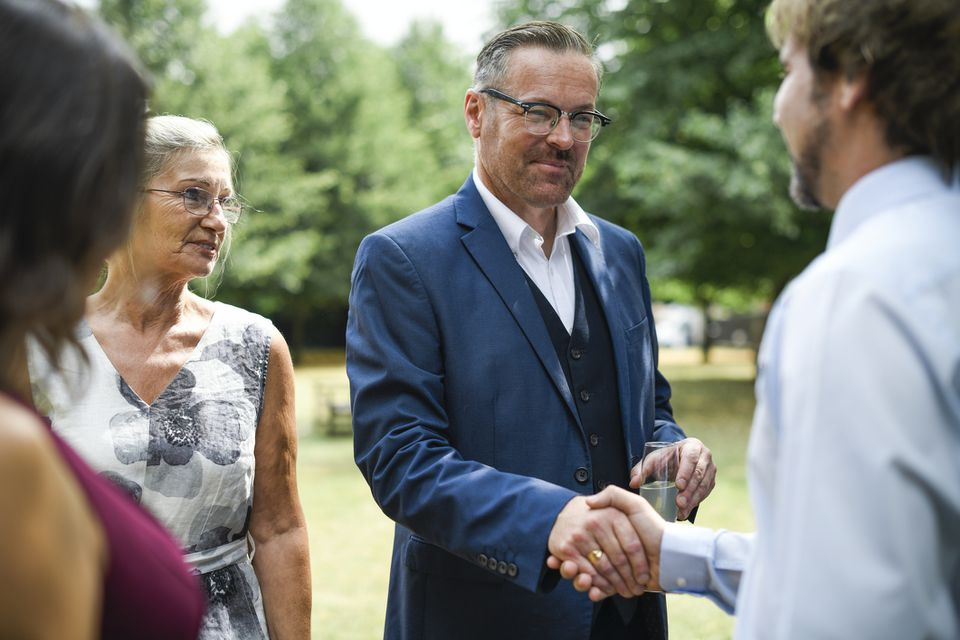 Fathers of the bride and groom shaking hands