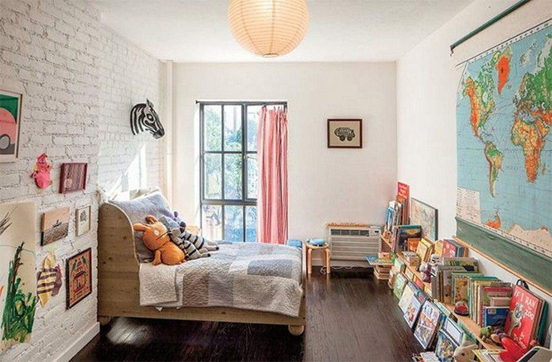 kids bedroom with a brick wall
