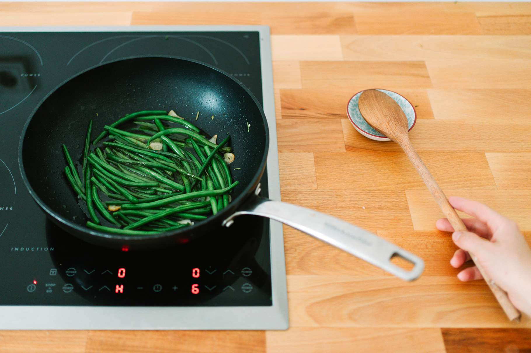 using a spoon rest instead of placing the utensil on the stove top