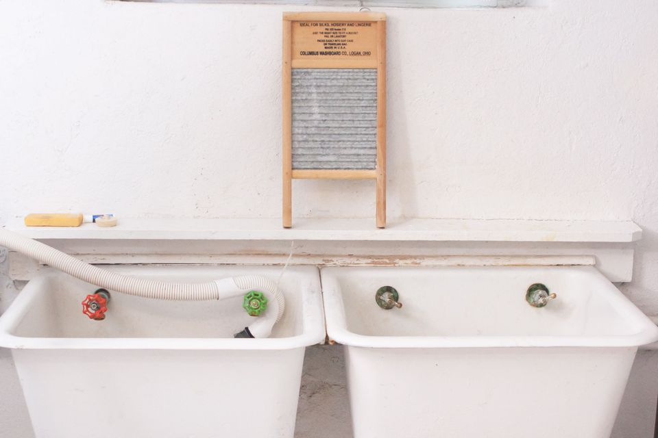 a pair of laundry room sinks