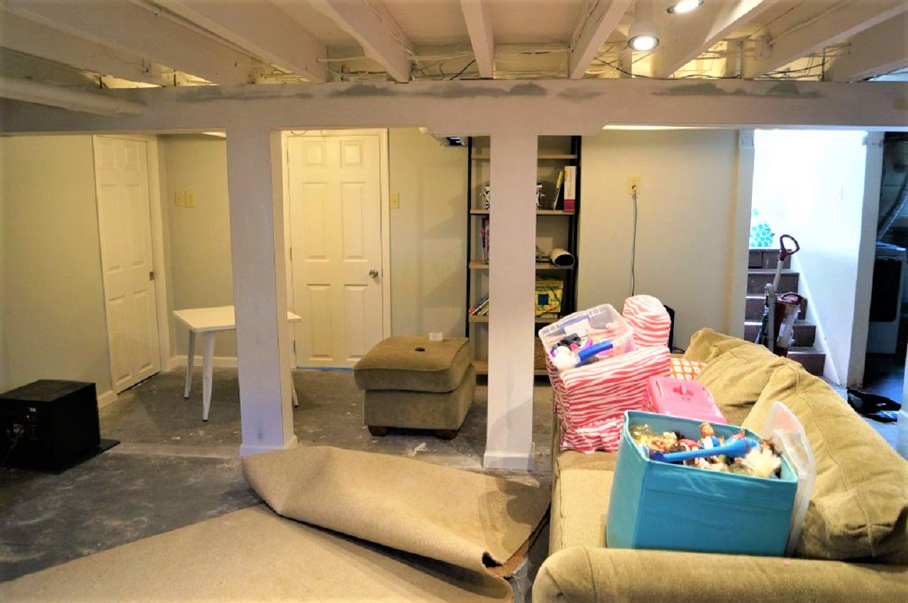 Cluttered Basement Space Before Remodeling