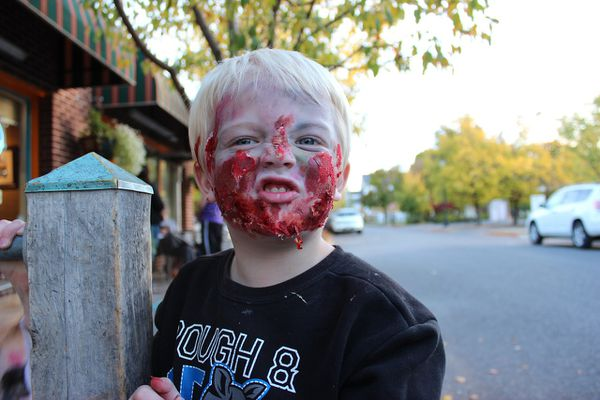 A boy wearing zombie face paint