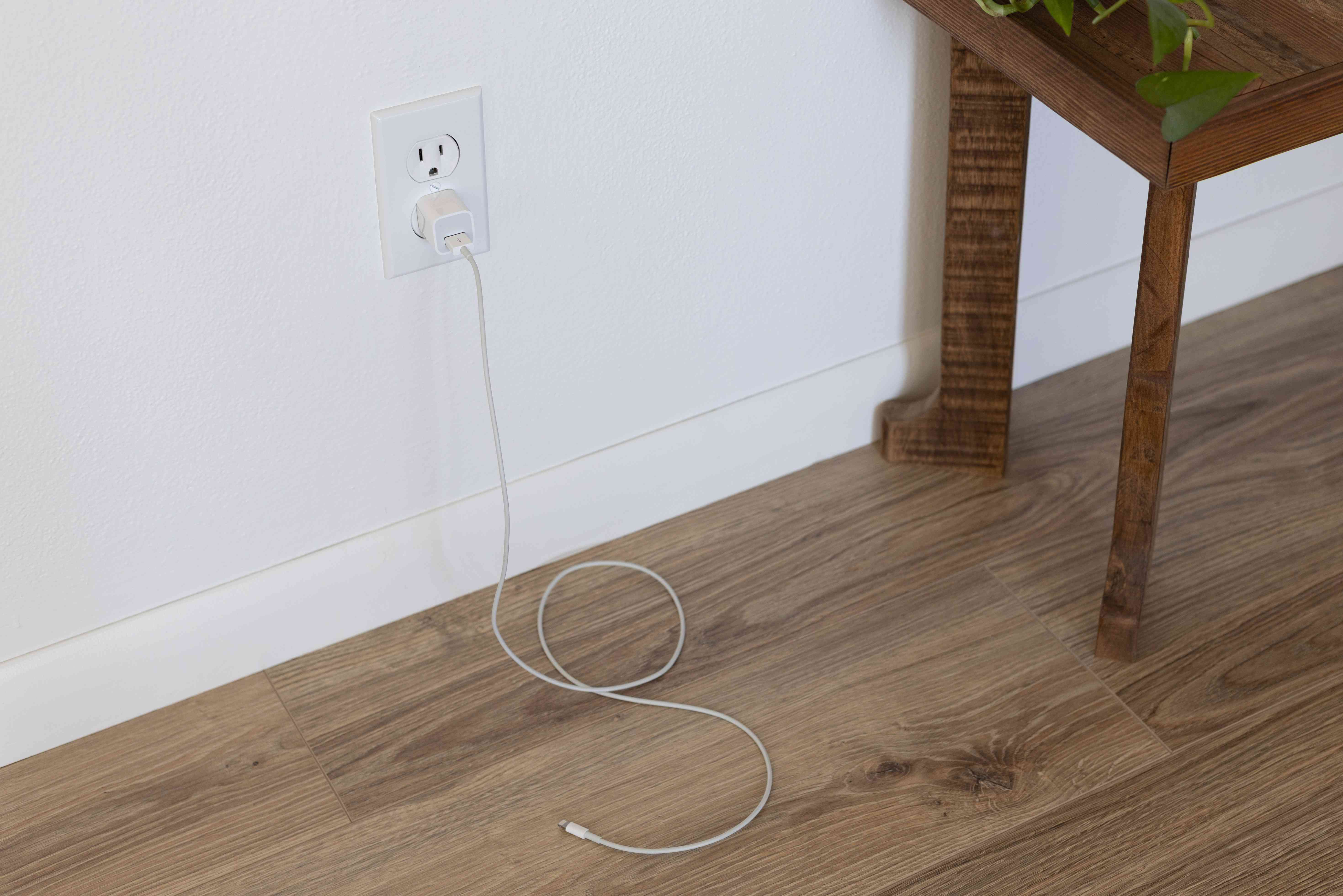 Phone charger plugged into wall creating phantom charge