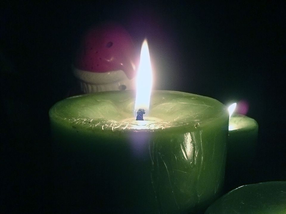 A close-up of a scented candle burning