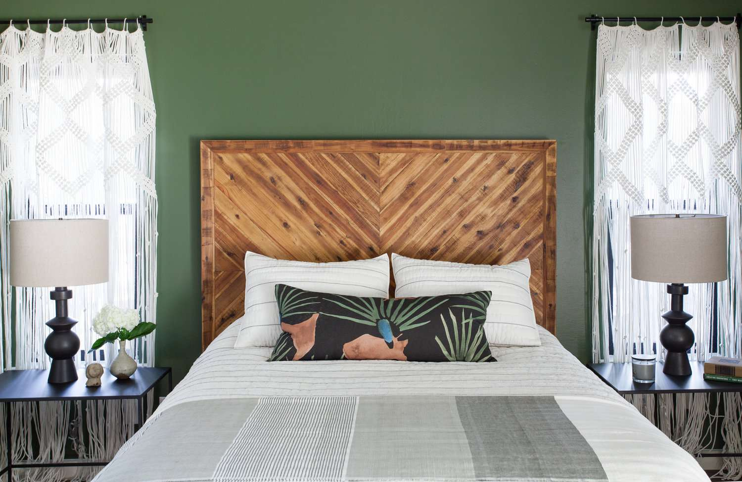 green bedroom with tall headboard, accent tables scaled ti match bed