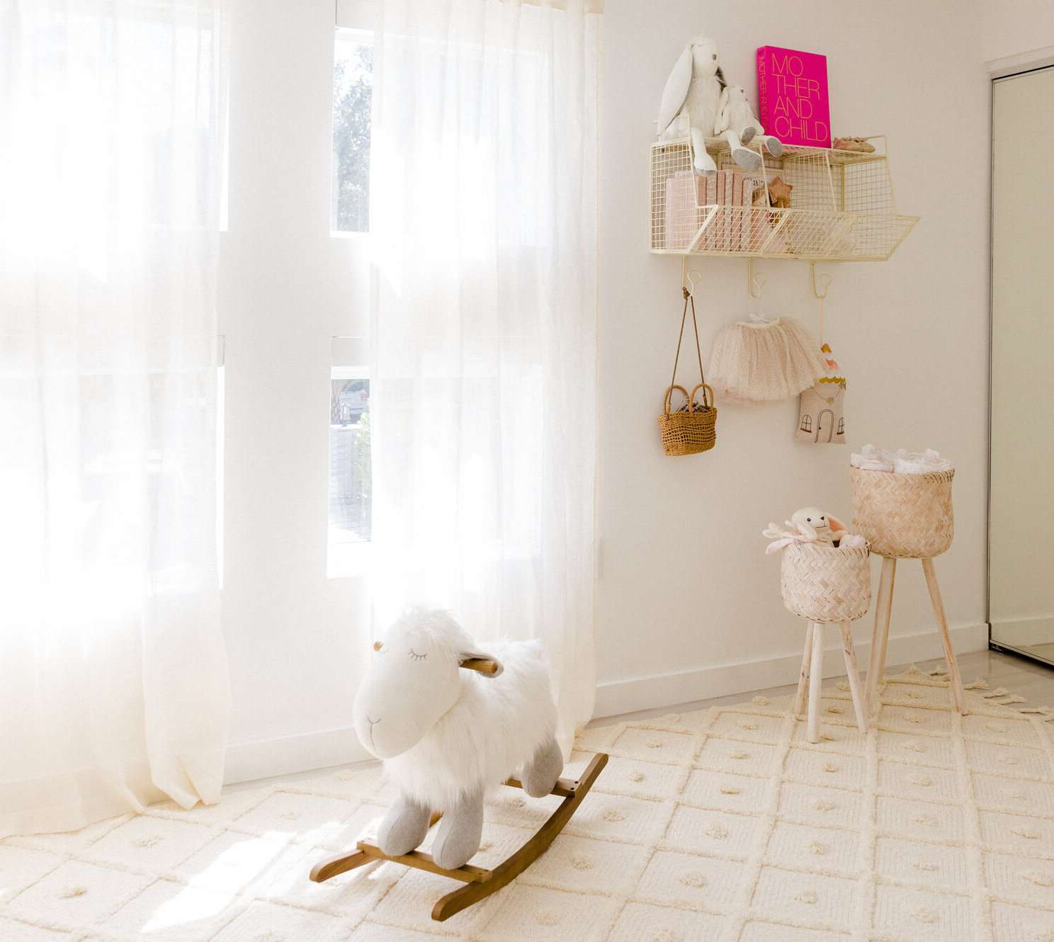 white nursery with wall hangin storage and hooks