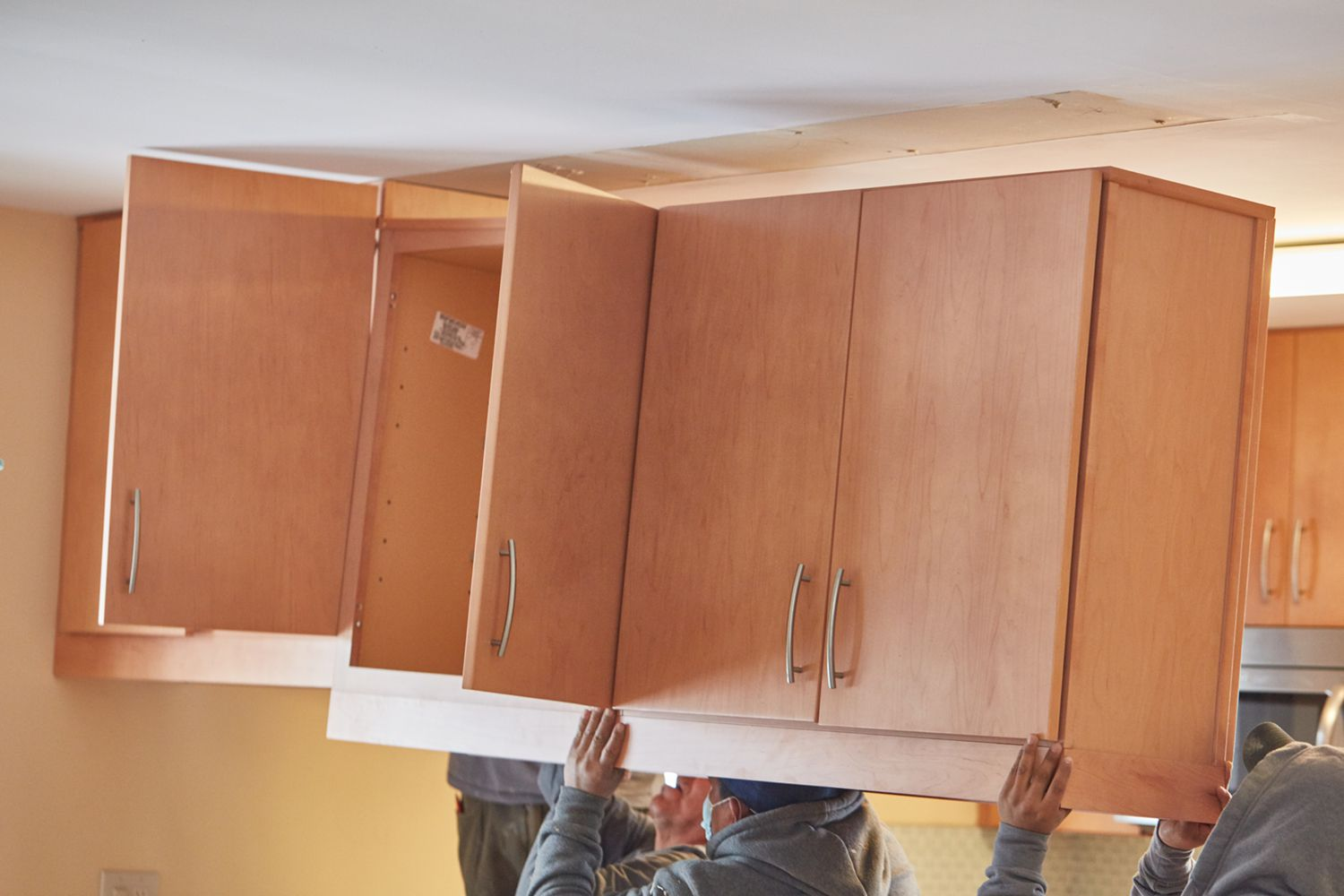 Wooden cabinets being removed for kitchen remodel