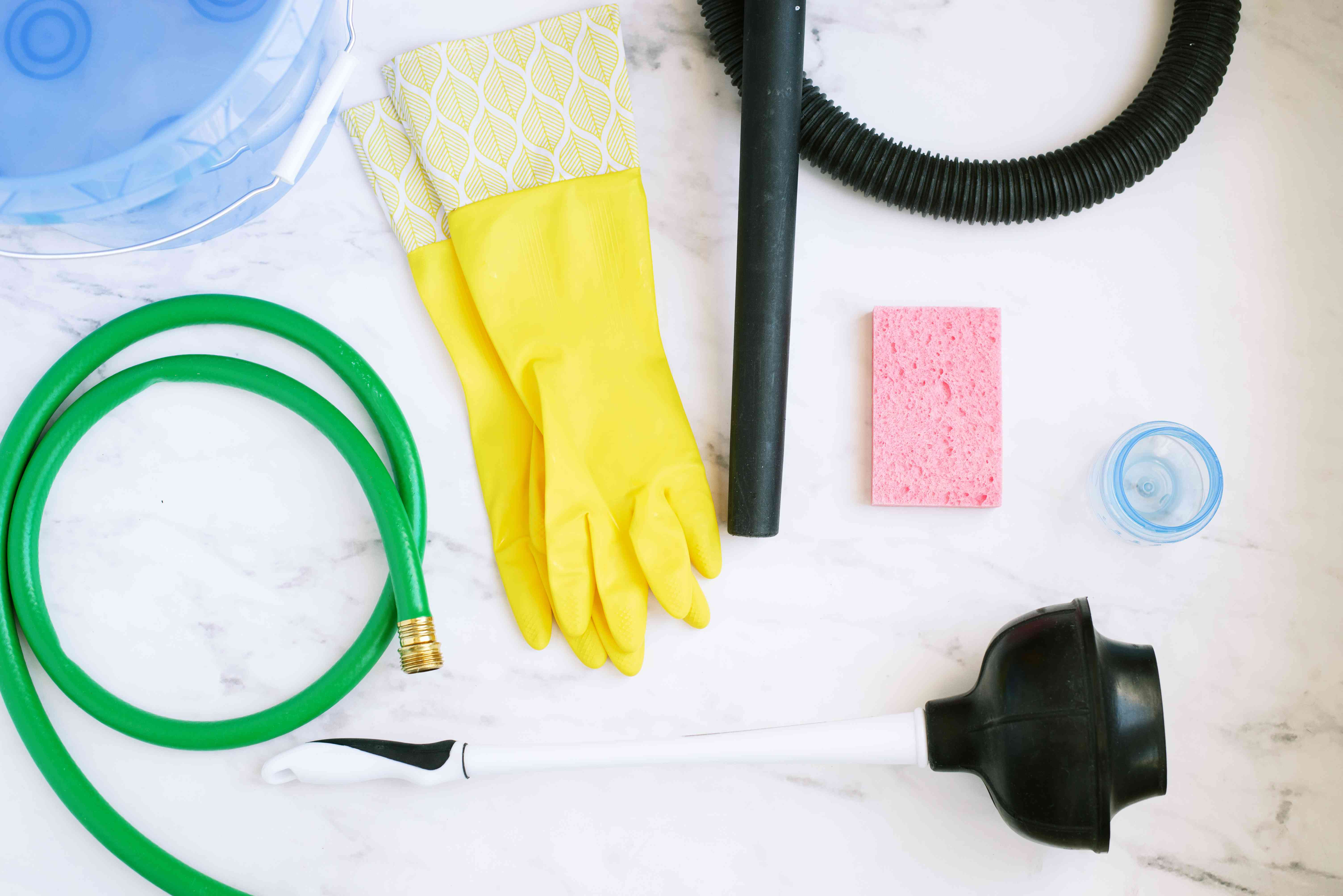 Materials and tools to drain out a toilet