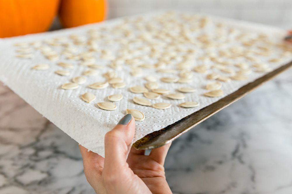 pumpkin seeds on a cookie sheet