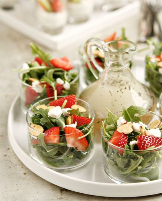 Miniature salads on tray with dressing