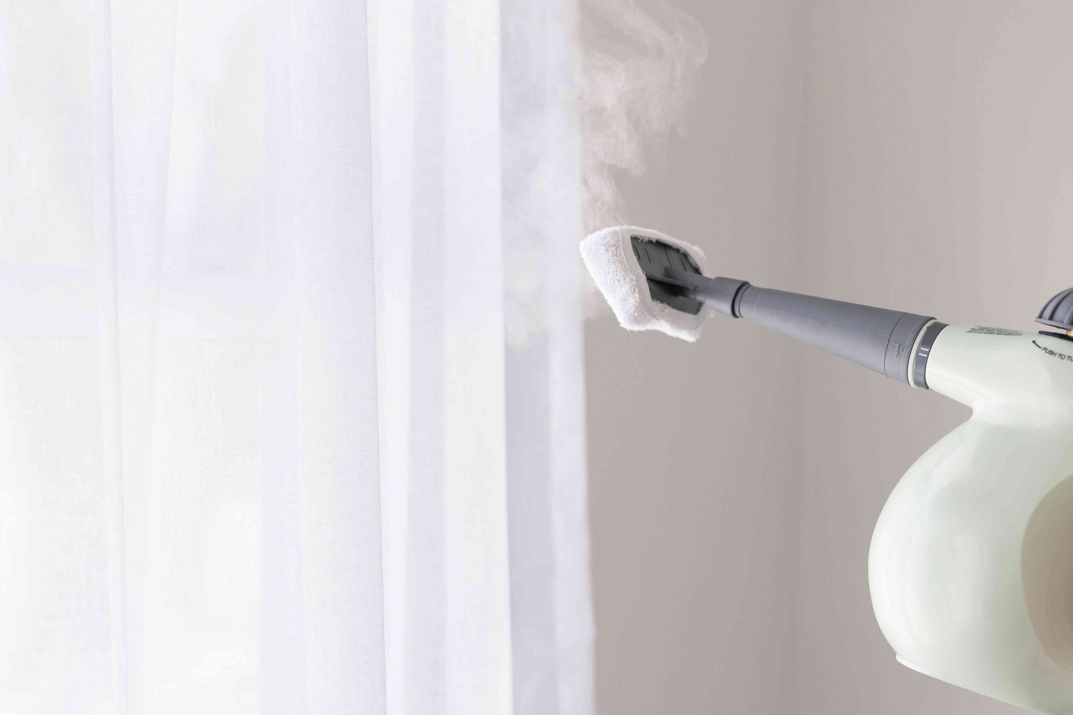 steam-cleaning a curtain