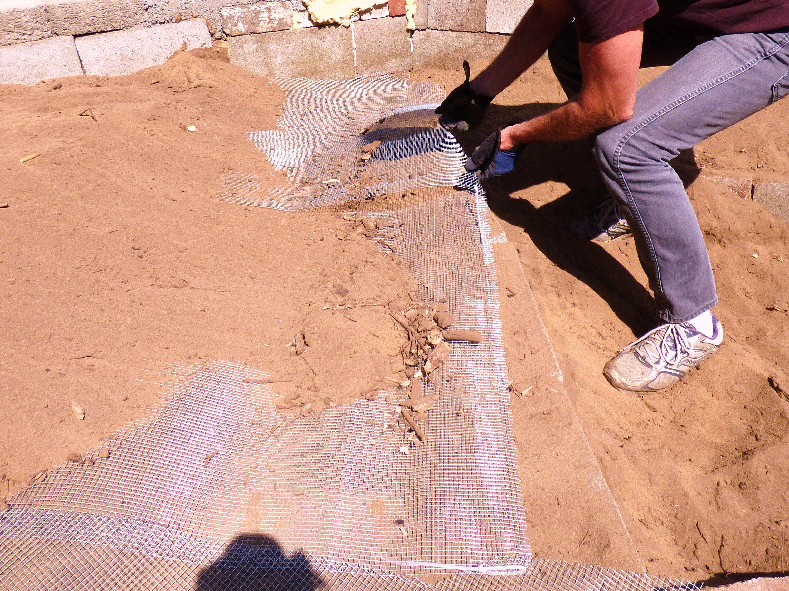 Man laying ground hardware