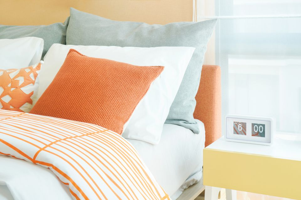 Orange accents in a bedroom