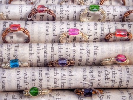 Multi Color Gemstone Rings Between Pages Of Books