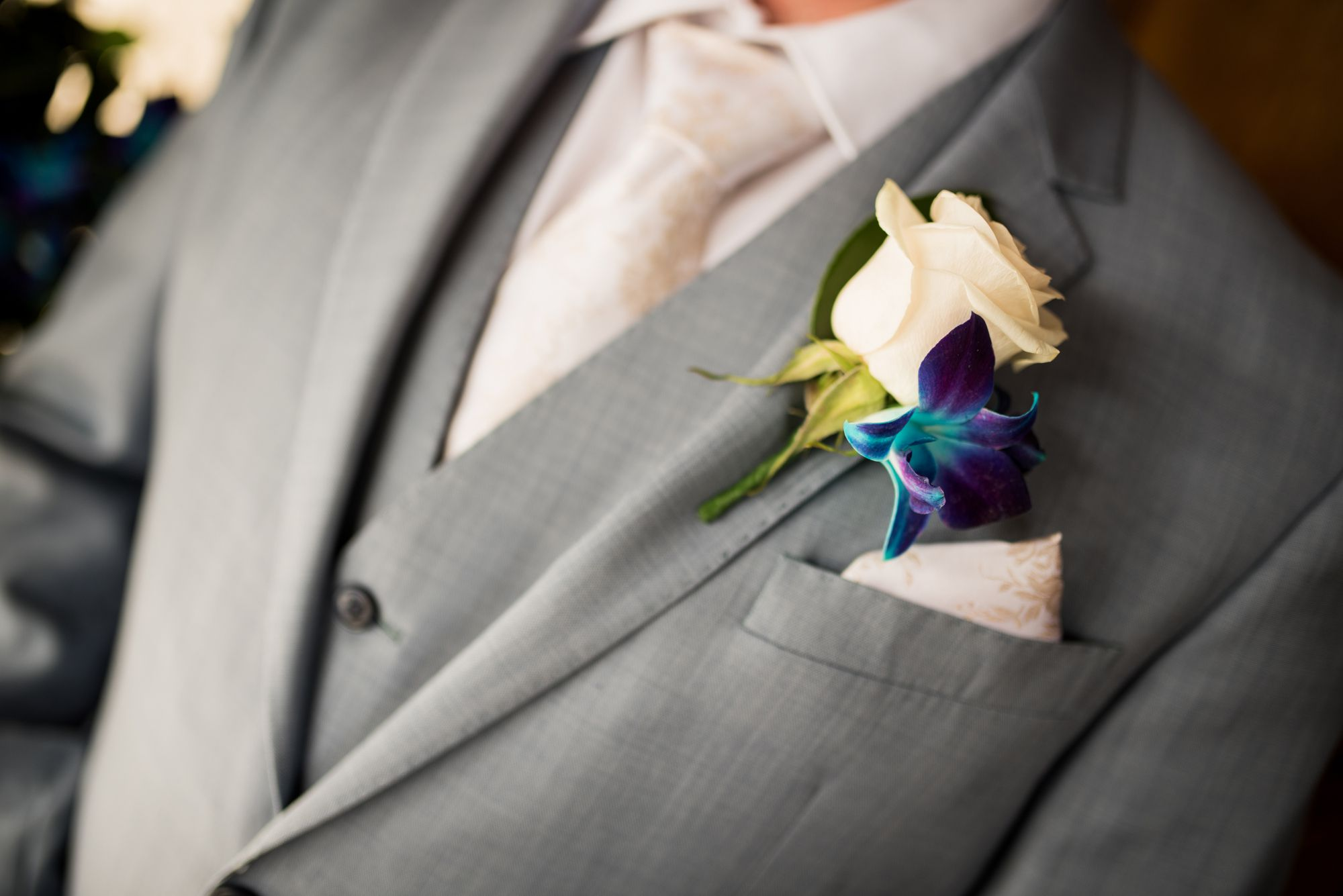 Groom's boutonniere with rose and orchid