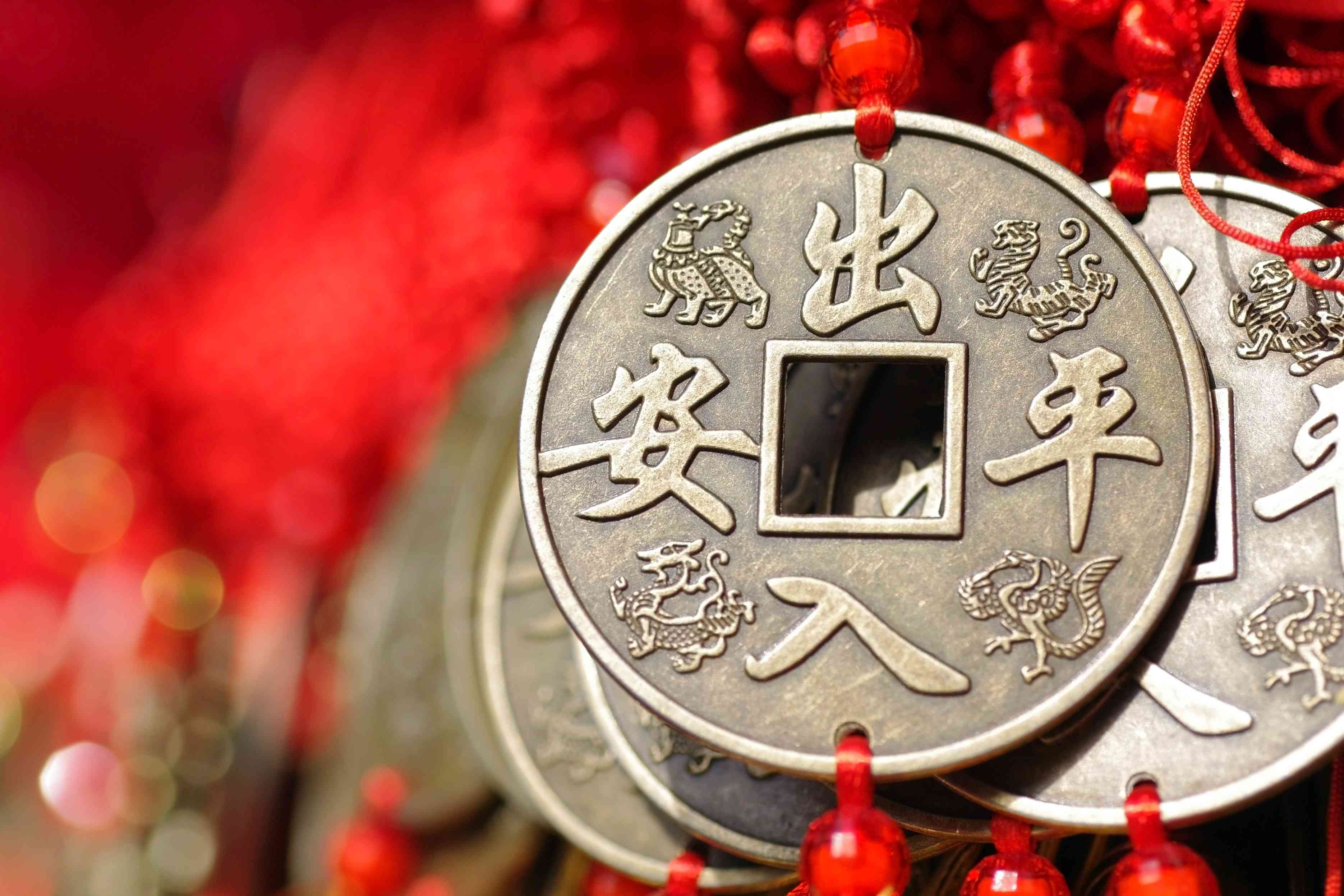 Chinese knot tassel decorations with reproductions of ancient copper coins.
