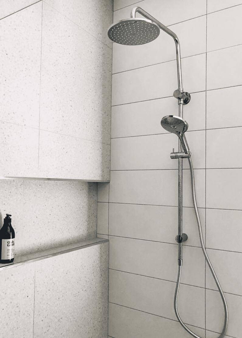 bathroom with terrazzo wall