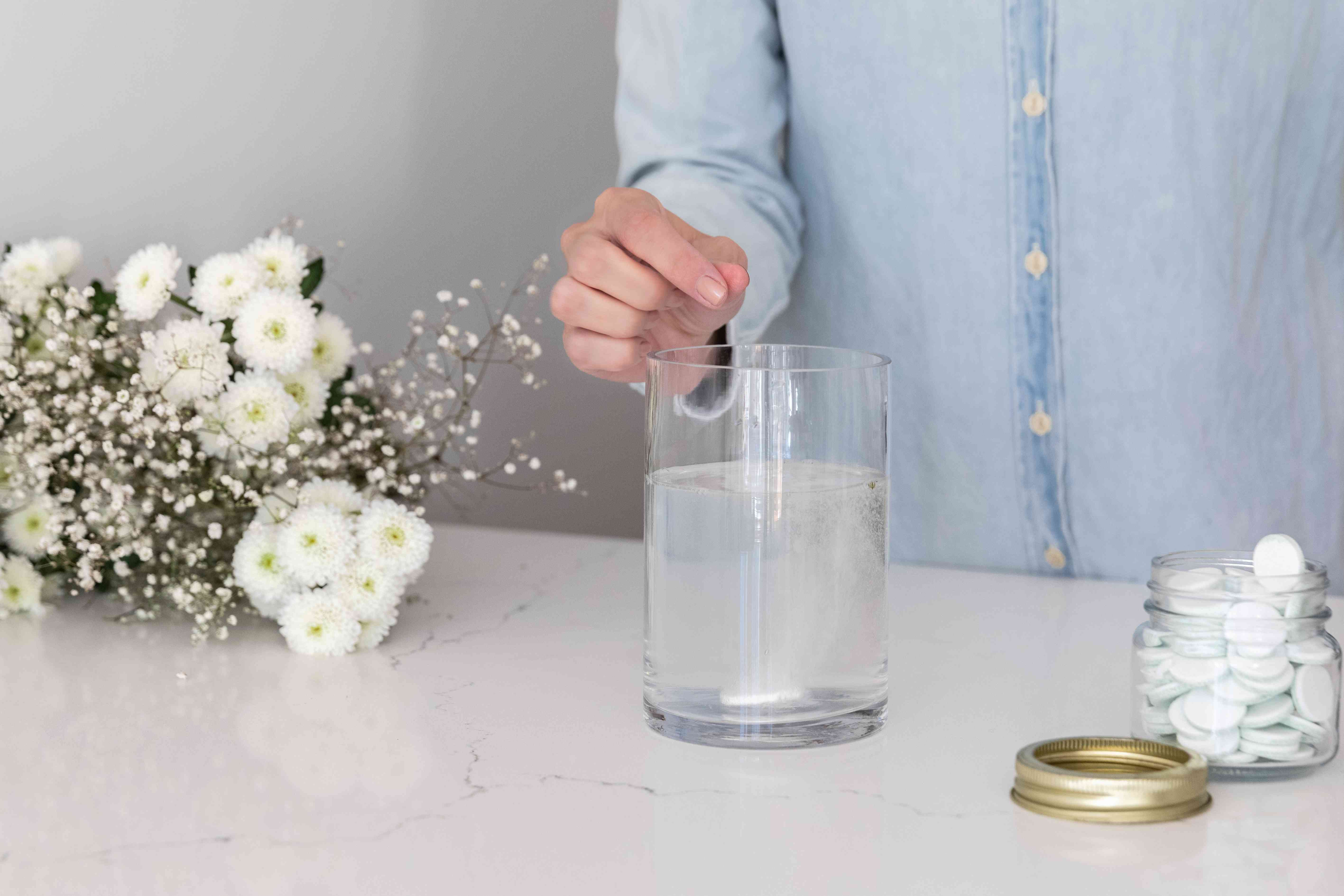 cleaning a vase with a denture tablet