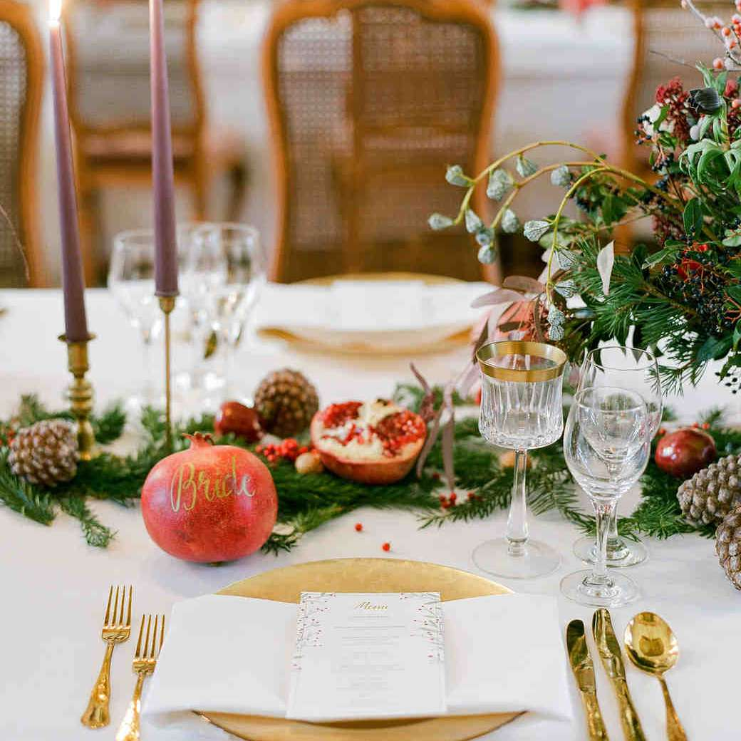 Evergreen, Pinecone, Candles, and Pomegranate Winter Wedding Centerpiece