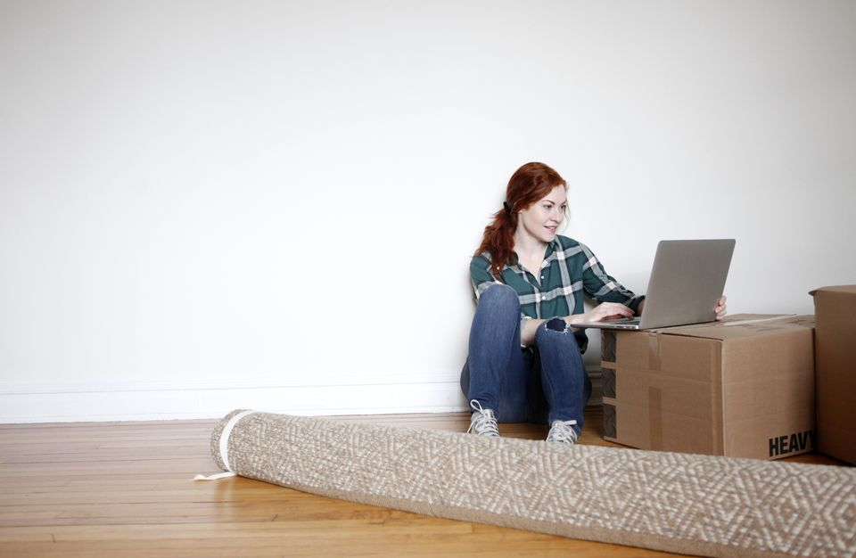 Woman on laptop in new apartment