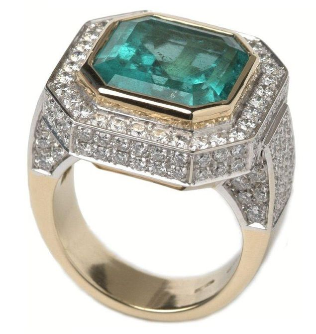 Emerald and diamond engagement ring.